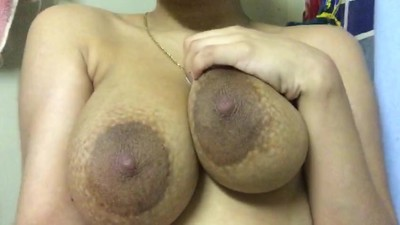 Milf plays with boobs