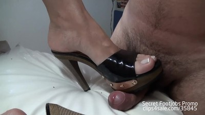 Andrea gives hot footjob in..