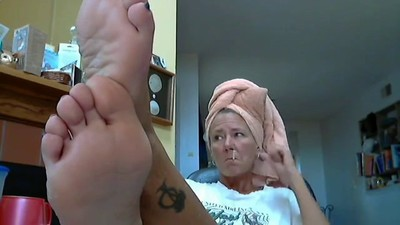 Mature shows feet