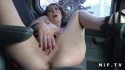 Mature fingering in a car..