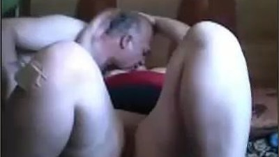 Older mature couple kissing..