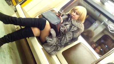 mature legs on train