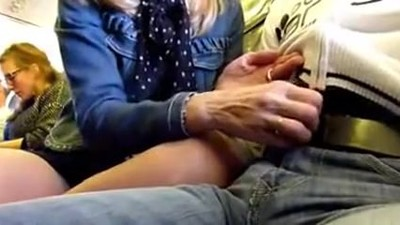 Blonde MILF Gives Handjob on..