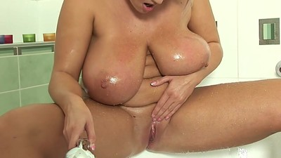 Chubby Milf Plays In The..