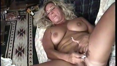 blonde milf slut plays with..