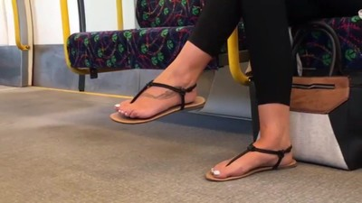 Candid feet in sandals with..