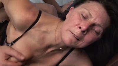 Mature masturbates with toy..